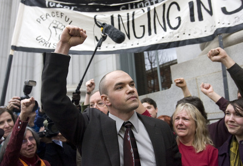 AL HARTMANN      Tribune File Photo An undaunted and defiant Tim DeChristopher rallies his supporters after being found guilty of crashing a federal oil and gas lease auction outside the Frank Moss Federal Courthouse in Salt Lake City March 3.