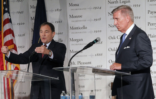 Al Hartmann  |  The Salt Lake Tribune Peter Cooke, right, listens while Gov. Gary Herbert defends his record on job-creation and education. Cooke is challenging the Republican incumbent, saying his leadership has been too weak for the problems faced by Utah.
