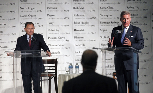 Al Hartmann  |  The Salt Lake Tribune  Gov. Gary Herbert, left, waits for a chance to respond to criticisms of Democratic challenger Peter Cooke during a debate Friday before the Utah League of Cities and Towns.