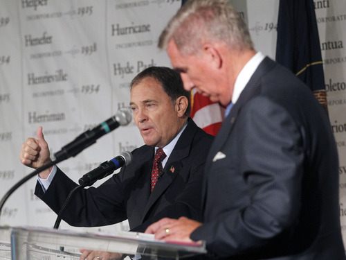 Al Hartmann  |  The Salt Lake Tribune Gov. Gary Herbert defended his leadership against complaints hurled by challenger Peter Cooke. Herbert said if a person doesn't believe in the state they shouldn't be running for governor.