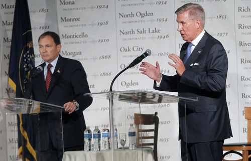 Al Hartmann  |  The Salt Lake Tribune Gov. Gary Herbert, left, defended Utah's economic and education track record against sharp criticisms from challenger Peter Cooke during a debate Friday hosted by the Utah League of Cities and Towns.