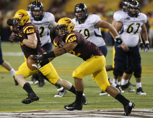 Arizona State safety Viliami Moeakiola intercepts the ball against the Northern Arizona during the first half of a football game on Thursday, Aug. 30 2012, in Tempe, Ariz. (AP Photo/Rick Scuteri)