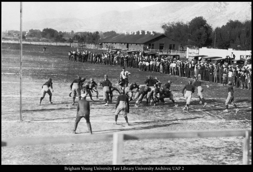 For the first few years after the revival of football at BYU, many games were played at the old Timp Park, just south of the present Provo power plant. There were no grandstands, and automobiles and spectators lined up along the sidelines. Later, football was moved to Upper Campus at the old grandstand, which, in the absence of football, had been used primarily as a track. Courtesy of BYU
