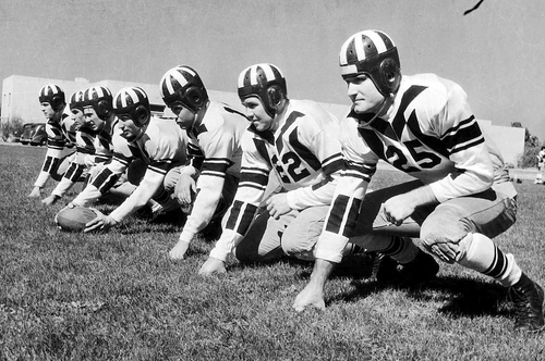 Eddie Kimball's football teams were colorful and visible. This formidable line in 1937 included Merrill Watters, left; Hafen Leavitt, Vaughn Lloyd (all-American), Chad Beckstead, Gerald Gillespie, Forrest Bird, and Wayne Soffe. In its best season to that time, BYU finished third in a twelve-team league. Courtesy of BYU