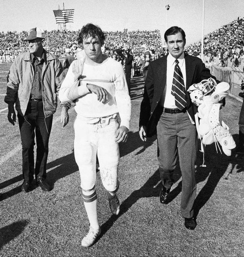 BYU's Gary Shieded, the nation's number two quarterback, leaves the field with his arm in a sling as a result of a shoulder separation three minutes before the end of the first quarter in the Fiesta Bowl Game, December 28, 1974, dimming BYU's hopes for a win in its first football bowl game. Courtesy of BYU