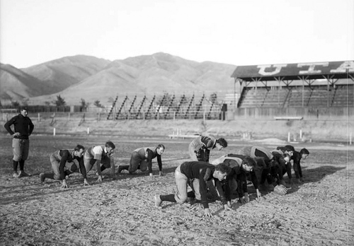 The University of Utah football players posing for a team photo in practice stance in 1907. Courtesy Utah Historical Society