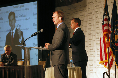 Al Hartmann  |  The Salt Lake Tribune Candidates for Salt Lake County mayor,  Ben McAdams , left, and Mark Crockett debate at the Utah League of Cities and Towns annual conference Friday September 14.