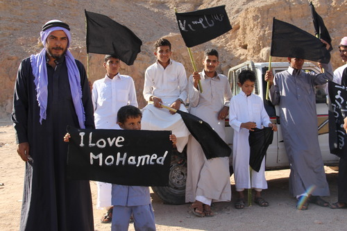 Sinai Bedouin protest as part of widespread anger across the Muslim world about a film ridiculing Islam's Prophet Muhammad in the central Sinai oasis of Wadi Feran, Egypt, Friday, Sept. 14, 2012. (AP Photo/Mohammed Sabry)