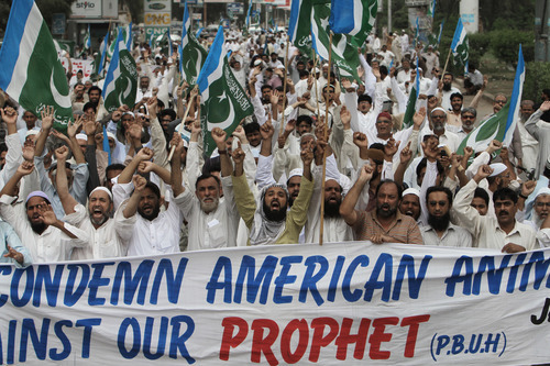 Supporters of Pakistani religious party Jamaat-e-Islami cahnt slogans during a demonstation, in Karachi, Pakistan on Friday, Sept. 14, 2012, as part of widespread anger across the Muslim world about a film ridiculing Islam's Prophet Muhammad. (AP Photo/Fareed Khan)