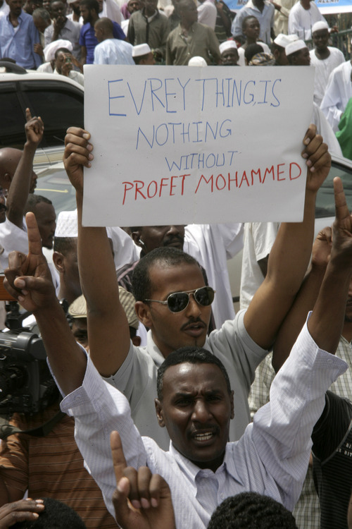 A Sudanese protester holds a placard during a protest in Khartoum, Sudan, Friday, Sept. 14, 2012, as part of widespread anger across the Muslim world about a film ridiculing Islam's Prophet Muhammad. Germany's Foreign Minister says the country's embassy in the Sudanese capital of Khartoum has been stormed by protesters and set partially on fire. Minister Guido Westerwelle told reporters that the demonstrators are apparently protesting against an anti-Islam film produced in the United States that denigrates the Prophet Muhammad.(AP Photo/Abd Raouf)