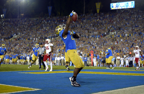 UCLA running back Johnathan Franklin celebrates after scoring a touchdown during the second half of their NCAA football game against Nebraska, Saturday, Sept. 8, 2012, in Pasadena, Calif. UCLA won 36-30. (AP Photo/Mark J. Terrill)