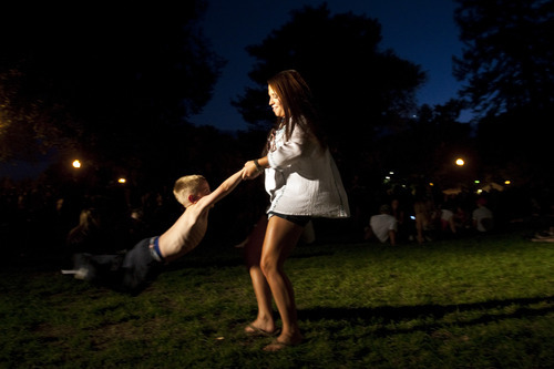 Chris Detrick  |  The Salt Lake Tribune   Kendra Gille swings around Liam Riding, 4, during the 'She and Him' performance at the final Twilight Concert at Pioneer Park Thursday August 26, 2010.