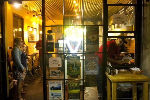Chris Detrick  |  The Salt Lake Tribune   Pierre Vandamme serves Belgian waffles at 'Bruges Waffles & Frites' after the 'She and Him' performance at the final Twilight Concert at Pioneer Park Thursday August 26, 2010.