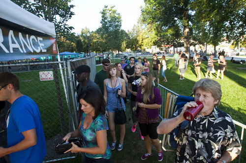 Chris Detrick  |  The Salt Lake Tribune   Concertgoers enter Pioneer Park before the 'She and Him' performance at the final Twilight Concert at Pioneer Park Thursday August 26, 2010.