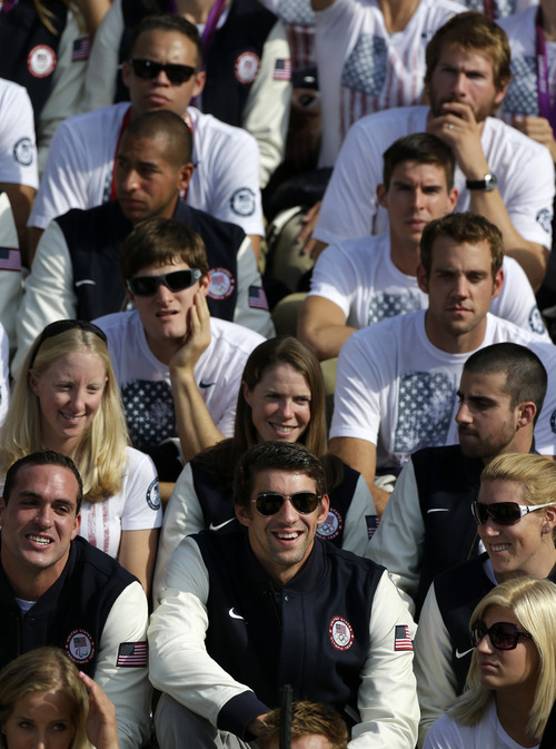 Olympic swimmer Michael Phelps, front row, center, smiles as he sits with fellow Olympians during a ceremony on the South Lawn of the White House in Washington, Friday, Sept. 14, 2012, where President Barack Obama welcomed the 2012 U.S. Olympic and Paralympic teams. Phelps ended his Olympic career in London with six medals and a record tally of 22 career medals. (AP Photo/Pablo Martinez Monsivais)