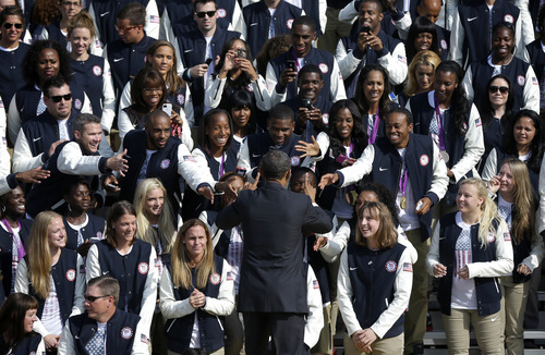 President Barack Obama stops to greet athletes on the South Lawn of the White House in Washington, Friday, Sept. 14, 2012, during a ceremony welcoming the 2012 U.S. Olympic and Paralympic teams. (AP Photo/Pablo Martinez Monsivais)