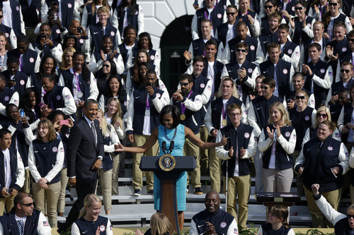 President Barack Obama and first lady Michelle Obama welcome members of the 2012 U.S. Olympic and Paralympic teams, Friday, Sept. 14, 2012, on the South Lawn of the White House in Washington.(AP Photo/Pablo Martinez Monsivais)