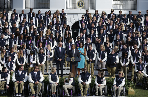 President Barack Obama, Vice President Joe Biden and first lady Michelle Obama, welcome members of the 2012 U.S. Olympic and Paralympic teams, Friday, Sept. 14, 2012, on the South Lawn of the White House in Washington. (AP Photo/Pablo Martinez Monsivais)