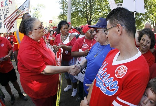Karen Lewis, president of the Chicago Teachers Union, left, works the crowd before addressing union members during a rally Saturday, Sept. 15, 2012, in Chicago. Lewis reminded that although there is a
