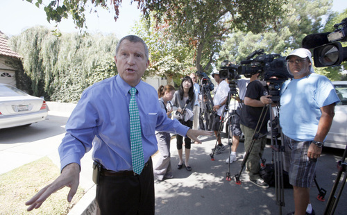 Los Angeles Sheriff's Department spokesman Steve Whitmore speaks to media outside the home of Nakoula Basseley Nakoula Thursday Sept. 13, 2012 in Cerritos, Calif.  Nakoula, has said that he helped with logistics for the filming of