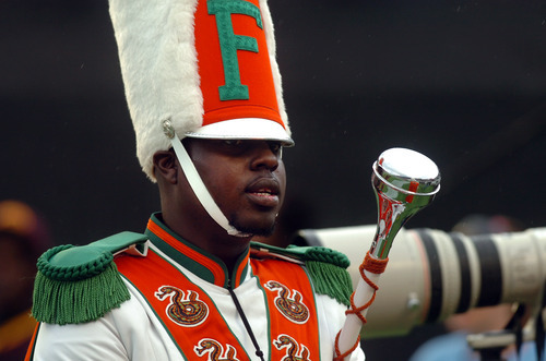 FILE - In this Saturday, Nov. 19, 2011 file photo, Robert Champion, a drum major in Florida A&M University's Marching 100 band, performs during halftime of a football game in Orlando, Fla. The parents of Robert Champion held a news conference in Atlanta, Thursday, Sept. 13, 2012, to voice their disappointment at FAMU's response to their lawsuit. They claim that FAMU is not taking responsibility for the safety of their students. (AP Photo/The Tampa Tribune, Joseph Brown III, File) SST. PETERSBURG OUT; LAKELAND OUT; BRADENTON OUT; MAGS OUT; LOCAL TV OUT; WTSP CH 10 OUT; WFTS CH 28 OUT; WTVT CH 13 OUT; BAYNEWS 9 OUT