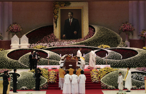 Bereaved family members carry a coffin containing a body of the late Rev. Sun Myung Moon, the controversial founder of the Unification Church, during his funeral service at the CheongShim Peace World Center in Gapyeong, South Korea, Saturday, Sept. 15, 2012. (AP Photo/Ahn Young-joon)