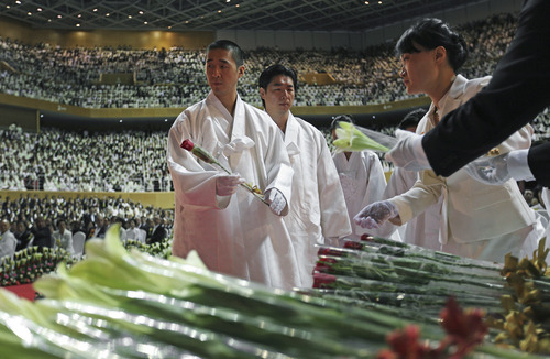 The Rev. Hyung-jin Moon, the youngest son of late Rev. Sun Myung Moon, attends his father's funeral at the CheongShim Peace World Center, Gapyeong, South Korea, Saturday, Sept. 15, 2012. (AP Photo/Hye Soo Nah)