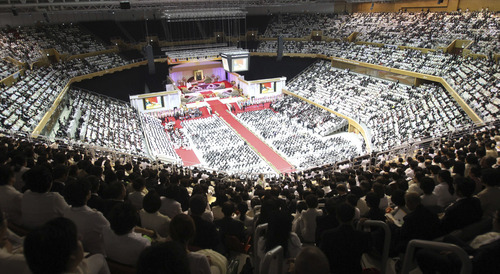 Mourners gather during a funeral of late Rev. Sun Myung Moon, the controversial founder of the Unification Church, at the CheongShim Peace World Center in Gapyeong, South Korea, Saturday, Sept. 15, 2012. (AP Photo/Ahn Young-joon)