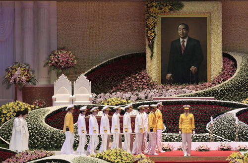 Unification Church honor guards carry a coffin containing a body of late Rev. Sun Myung Moon, the controversial founder of the Unification Church, after  his funeral service at the CheongShim Peace World Center in Gapyeong, South Korea, Saturday, Sept. 15, 2012. (AP Photo/Ahn Young-joon)