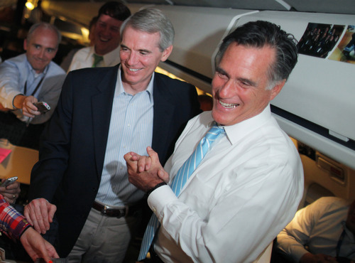 Republican presidential candidate and former Massachusetts Gov. Mitt Romney and Sen. Rob Portman, R-Ohio, talk to reporters on board the campaign charter plane as it flies to Bedford, Mass., Friday, Sept. 14, 2012. (AP Photo/Charles Dharapak)