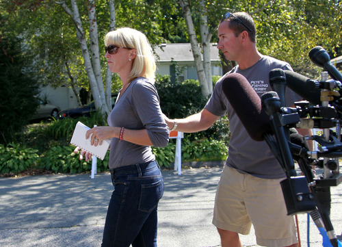 Kate Quigley, left, who says her brother Glen Doherty was among the Americans killed in an attack on the U.S. Consulate in Libya, is escorted away from microphones by her husband Mark Quigley, right, after speaking to reporters in Worburn, Mass., Thursday, Sept. 13, 2012. Four Americans were killed at the U.S. Consulate in Benghazi on Tuesday along with U.S. Ambassador Chris Stevens. (AP Photo/Steven Senne)