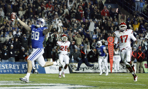 Scott Sommerdorf | The Salt Lake Tribune  BYU tight end Andrew George (88) scores the winning touchdown of the game during overtime in the BYU Utah game at Lavell Edwards Stadium in Provo, Utah, Saturday, November 28, 2009.