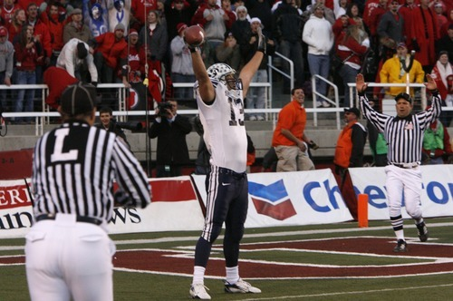 Jonny Harline catches the winning touchdown for BYU , on the last play of the game, in football action BYU vs Utah at Rices-Eccles Stadium.
