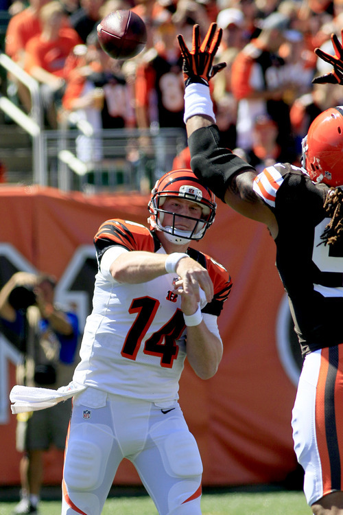 Cincinnati Bengals quarterback Andy Dalton (14) has a pass knocked down by Cleveland Browns defensive end Jabaal Sheard in the first half of an NFL football game, Sunday, Sept. 16, 2012, in Cincinnati. (AP Photo/Al Behrman)