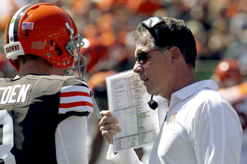 Cleveland Browns head coach Pat Shurmur, right, talks with quarterback Brandon Weeden (3) in the first half of an NFL football game against the Cincinnati Bengals, Sunday, Sept. 16, 2012, in Cincinnati. (AP Photo/Tom Uhlman)