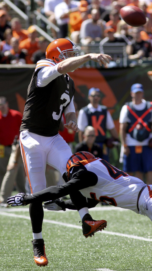 Cleveland Browns quarterback Brandon Weeden (3) throws under pressure from Cincinnati Bengals defensive back Jeromy Miles (45) in the first half of an NFL football game, Sunday, Sept. 16, 2012, in Cincinnati. (AP Photo/Tom Uhlman)