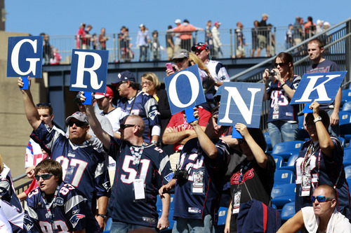 Fans cheer for New England Patriots tight end Rob Gronkowski before an NFL football game against the Arizona Cardinals, Sunday, Sept. 16, 2012, in Foxborough, Mass. (AP Photo/Steven Senne)