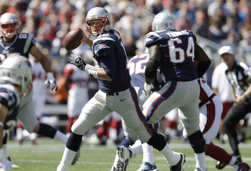 New England Patriots quarterback Tom Brady (12) looks for a receiver against the Arizona Cardinals in the first half of an NFL football game Sunday, Sept. 16, 2012 in Foxborough, Mass. (AP Photo/Elise Amendola)