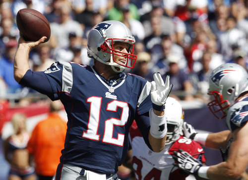 New England Patriots quarterback Tom Brady (12) passes against the Arizona Cardinals in the first quarter of an NFL football game Sunday, Sept. 16, 2012 in Foxborough, Mass. (AP Photo/Stephan Savoia)