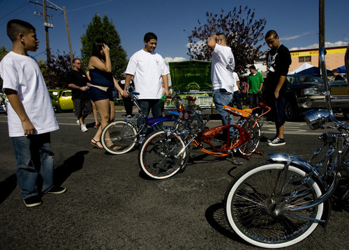 Kim Raff | The Salt Lake Tribune People look at Good Times Car Club's low rider bikes on display during the El Grito de la Independencia, Mexico's official independence day, festival and car show at Centro Civico Mexicano in Salt Lake City, Utah on September 16, 2012.
