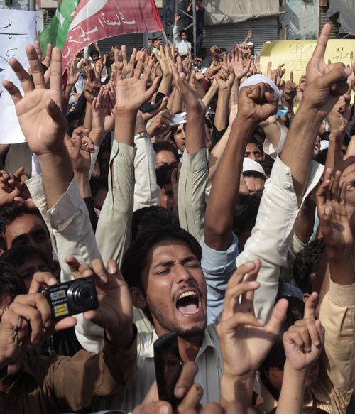 Supporters of a Pakistani Tehreek-e-Insaf or Movement for Justice chant slogans during a demonstration in Peshawar, Pakistan, Sunday, Sept. 16, 2012 as part of widespread anger across the Muslim world about a film ridiculing Islam's Prophet Muhammad. (AP Photo/Muhammad Sajjad)