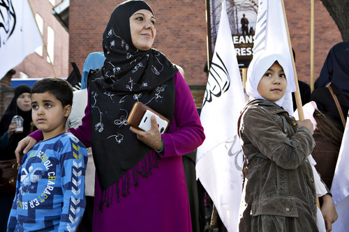 Members of Hizb ut-Tahrir , the global Islamic political party, demonstrate against the movie: Innocence of Muslims in front of the US Embassy in Copenhagen, Sunday, Sept. 16, 2012. (AP Photo/Polfoto, Jyllands-Posten, Stine Bidstrup)  DENMARK OUT