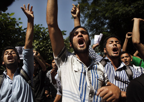 Kashmiri Muslim students shout slogans against the U.S. during a protest in Srinagar, India, Saturday, Sept. 15, 2012, as part of widespread anger across the Muslim world about a film ridiculing Islam's Prophet Muhammad.(AP Photo/Dar Yasin)