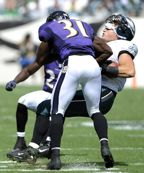 Philadelphia Eagles tight end Brent Celek, right, is tackled by Baltimore Ravens strong safety Bernard Pollard in the first half of an NFL football game on Sunday, Sept. 16, 2012, in Philadelphia. (AP Photo/Michael Perez)