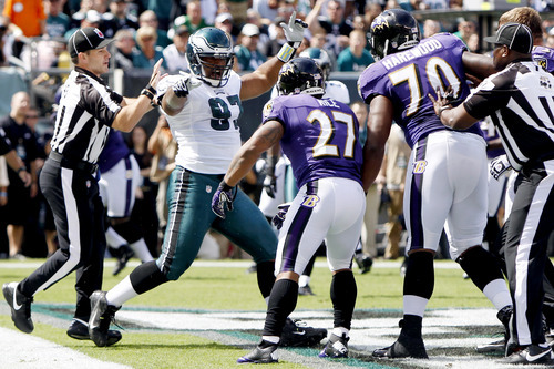Philadelphia Eagles' Cullen Jenkins (97), Baltimore Ravens' Ray Rice (27) and Ramon Harewood (70) are separated during a scuffle in the first half of an NFL football game, Sunday, Sept. 16, 2012, in Philadelphia. (AP Photo/Mel Evans)