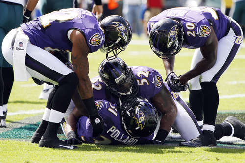 Baltimore Ravens' Bernard Pollard (31), Ray Lewis (52), Jimmy Smith (22) and Ed Reed (20) celebrate after Pollard intercepted a pass from Philadelphia Eagles quarterback Michael Vick in the first half of an NFL football game on Sunday, Sept. 16, 2012, in Philadelphia. (AP Photo/Mel Evans)