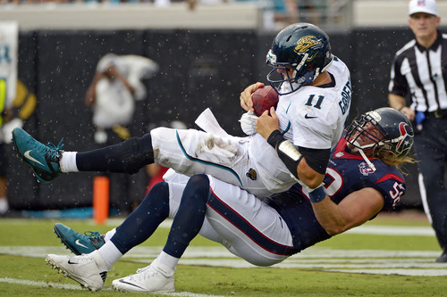 Jacksonville Jaguars quarterback Blaine Gabbert (11) is sacked by Houston Texans outside linebacker Brooks Reed (58) during the first half of an NFL football game, Sunday, Sept. 16, 2012, in Jacksonville, Fla. (AP Photo/Phelan M. Ebenhack)