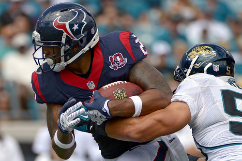 Houston Texans running back Arian Foster, left, is tackled after a short gain by Jacksonville Jaguars outside linebacker Russell Allen during the first half of an NFL football game, Sunday, Sept. 16, 2012, in Jacksonville, Fla. (AP Photo/Phelan M. Ebenhack)