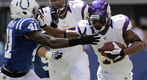 Minnesota Vikings' Percy Harvin, right, runs against Indianapolis Colts' Antoine Bethea during the first half of an NFL football game in Indianapolis, Sunday, Sept. 16, 2012. (AP Photo/AJ Mast)