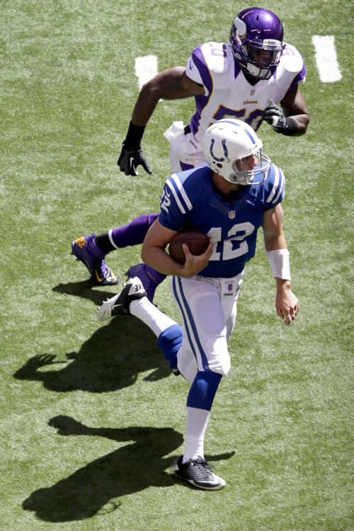 Indianapolis Colts quarterback Andrew Luck is chased by Minnesota Vikings' Erin Henderson during the first half of an NFL football game in Indianapolis, Sunday, Sept. 16, 2012. (AP Photo/AJ Mast)